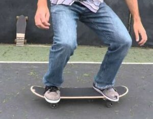 how to Stand-on-a-skateboard