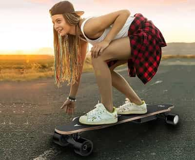 WeSkate 35 inch Electric Skateboard Longboard with Remote Controller girl riding